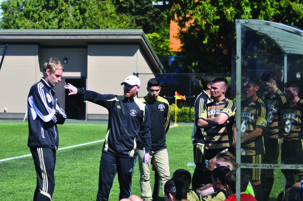 Cale Rodriguez, left, instructs the men's soccer team at the 2015 Rumble in the Rainforest. Photo by Giovanni Roverso