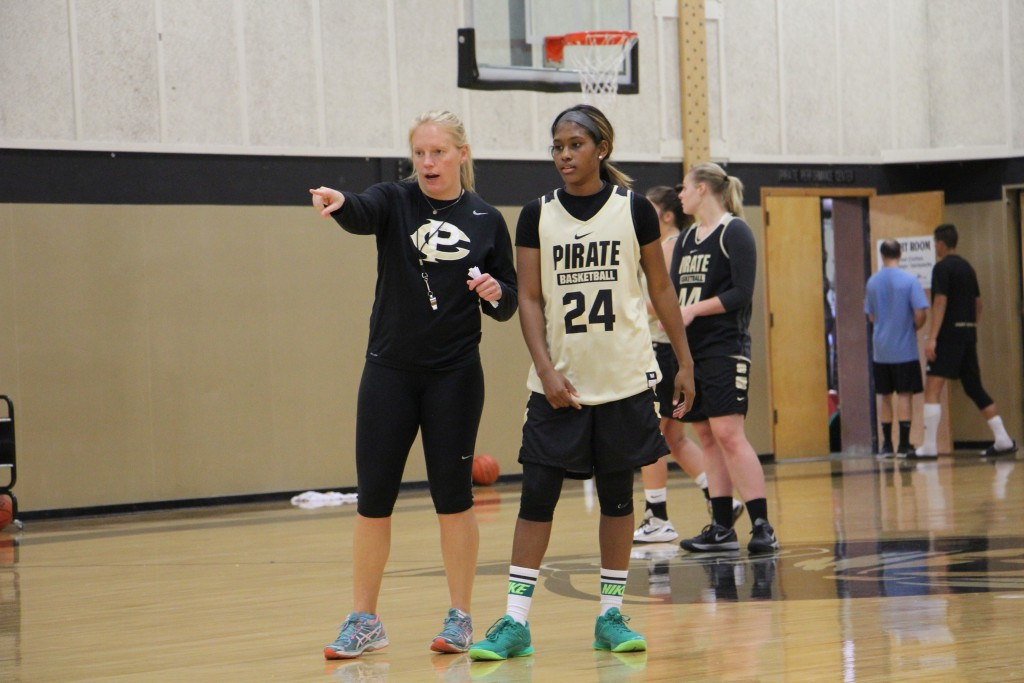 Head coach Ali Crumb and point guard Imani Smith. - Photo by Eric Trent