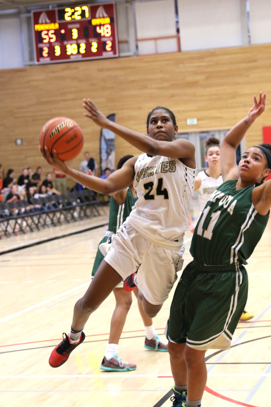 Imani Smith blows by an Umpqua defender for two points in the 2nd half of the quarterfinals.