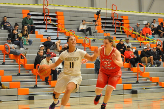 Cierra Moss drives in for a layup against Lower Columbia. - Photo by Mike Drake