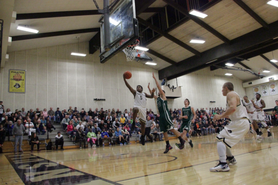 Darrion Daniels soars for a layup against Chemeketa. Daniels led all scorers with 19 points.