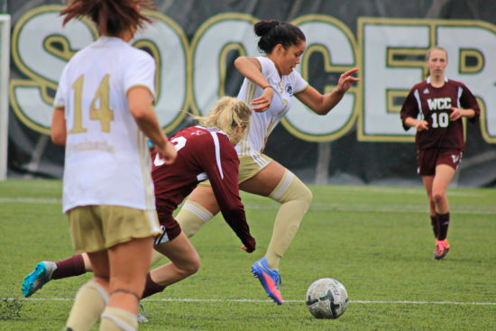 Hoku Afong splits defenders and sprints toward the goal vs Whatcom. - Photo by Ivan Sitohang